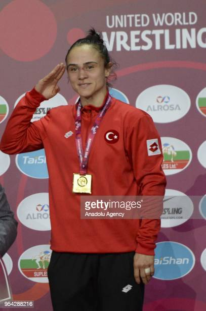 Turkey's Elif Jale Yesilirmak celebrates during the medal ceremony after receiving the gold medal following defeated Bulgarian opponent Mimi Nikolova...