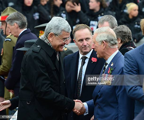 Turkey's EU Minister and Chief Negotiator Volkan Bozkir and Prince Charles of Wales shake hands during a memorial service at the New Zealand National...