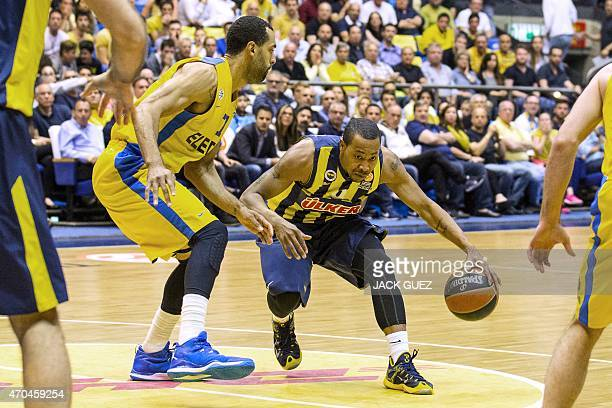 Turkey's Fenerbahce Ulker Istanbul's US guard Andrew Goudelock vies for the ball against Israel's Maccabi Electra Tel Aviv's US forward Brian Randle...