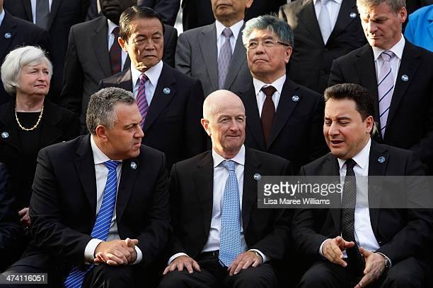 Turkey's Finance Minister Ali Babacan chats with Australia's Reserve Bank Governor Glenn Stevens and Australia's Treasurer Joe Hockey during the G20...