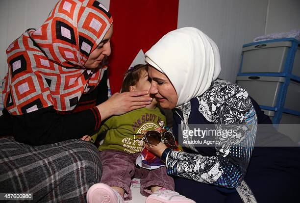 Turkey's First Lady Emine Erdogan cares a Syrian children during his visit to the Syrian Refugee Camp with Emir of Qatar Sheikh Tamim's mother...