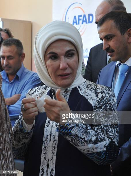 Turkey's First Lady Emine Erdogan cries on a moment during his visit to the Syrian Refugee Camp with Emir of Qatar Sheikh Tamim's mother Sheikha...