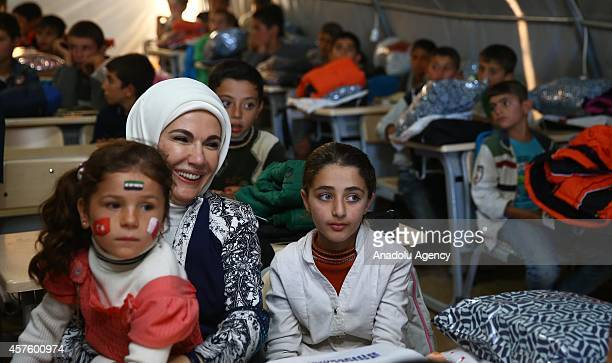 Turkey's First Lady Emine Erdogan listens Syrian children at a classroom during his visit to the Syrian Refugee Camp with Emir of Qatar Sheikh...