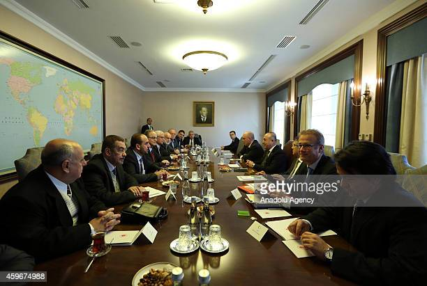 Turkey's Foreign Affairs Minister Mevlut Cavusoglu holds a meeting with President of the Syrian National Coalition Hadi alBahra at the Foreign...