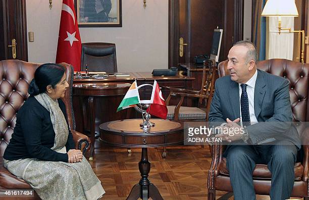 Turkey's Foreign Affairs minister Mevlut Cavusoglu talks to his Indian counterpart Sushma Swaraj prior to a meeting in Ankara on January 16 2015 AFP...