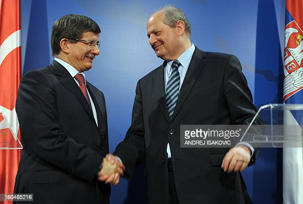 Turkey's Foreign Minister Ahmet Davutoglu shakes hand with his Serbian counterpart Ivan Mrkic at a press conference following their meeting in...