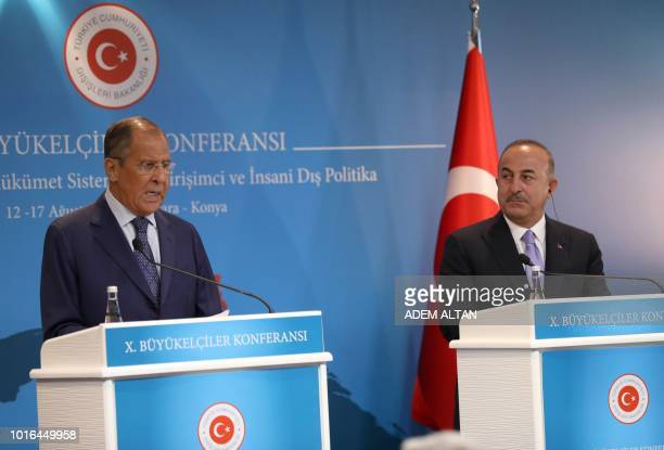 Turkey's Foreign Minister Mevlut Cavusoglu and his Russian counterpart Sergei Lavrov attend a joint press conference following their meeting in...