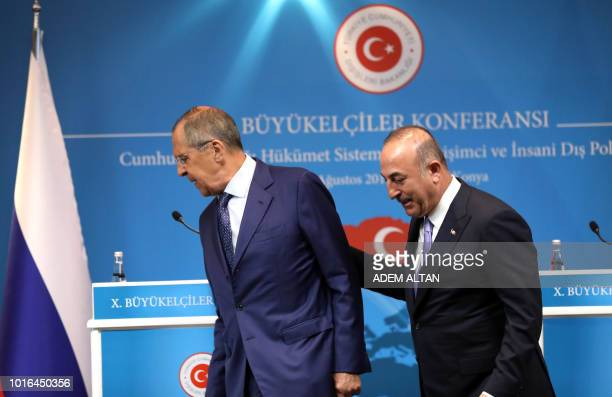 Turkey's Foreign Minister Mevlut Cavusoglu and his Russian counterpart Sergei Lavrov leave after a joint press conference following their meeting in...