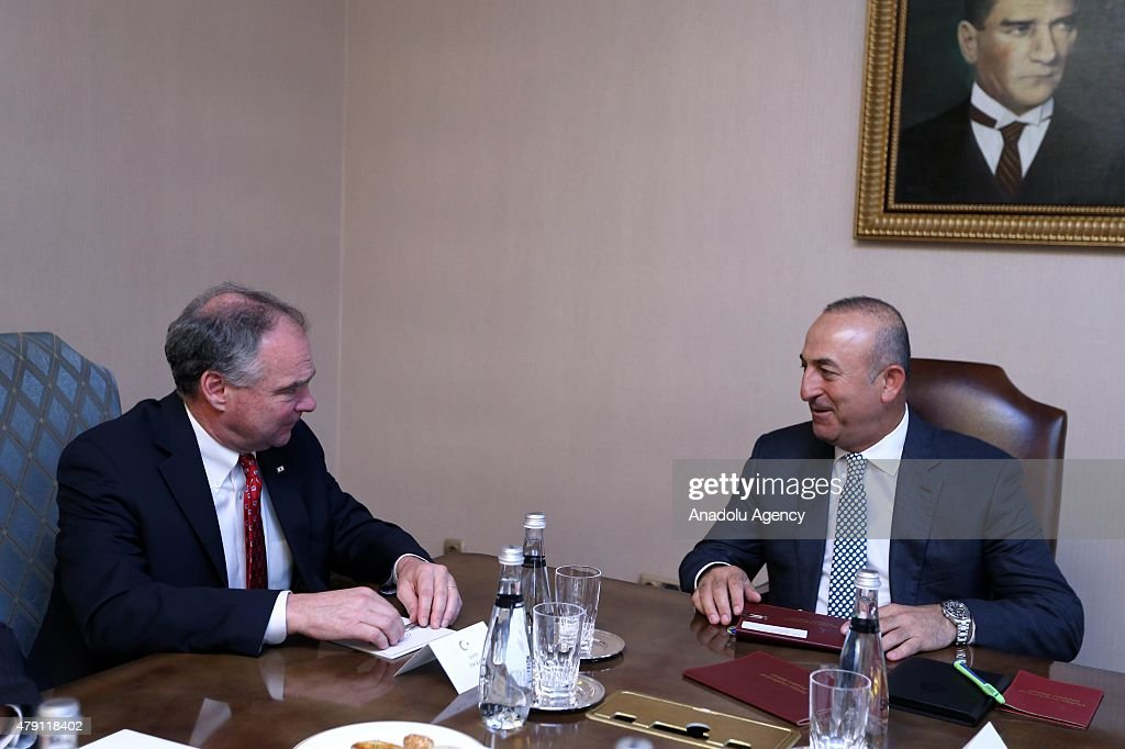 Turkey's Foreign Minister Mevlut Cavusoglu (R) and US Senator Tim Kaine (R) hold an inter delegation meeting in Ankara, Turkey on July 01, 2015.