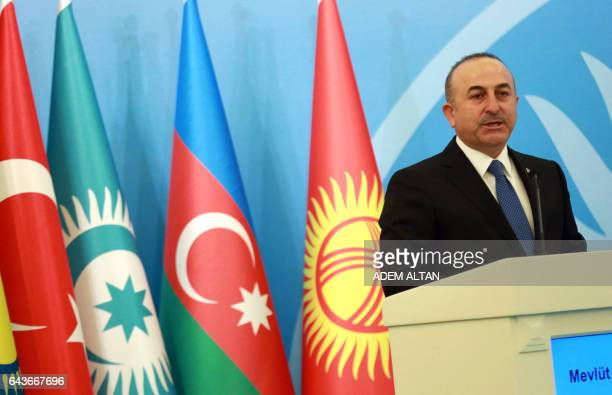 Turkey's Foreign Minister Mevlut Cavusoglu delivers a speech during a conference to commemorate the 25th anniversary of the Khojaly Massacre in...