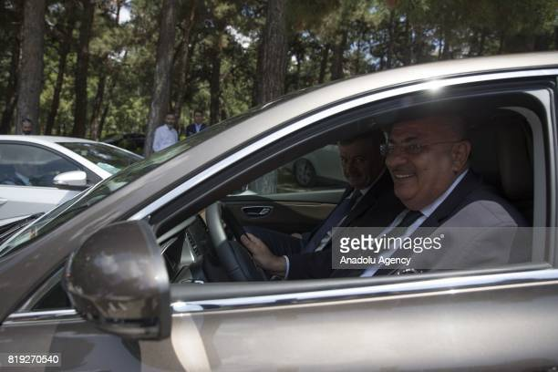Turkey's former Deputy Prime Minister Tugrul Turkes leaves Cankaya Palace with hi s own car after a handover ceremony following Turkish Cabinet...