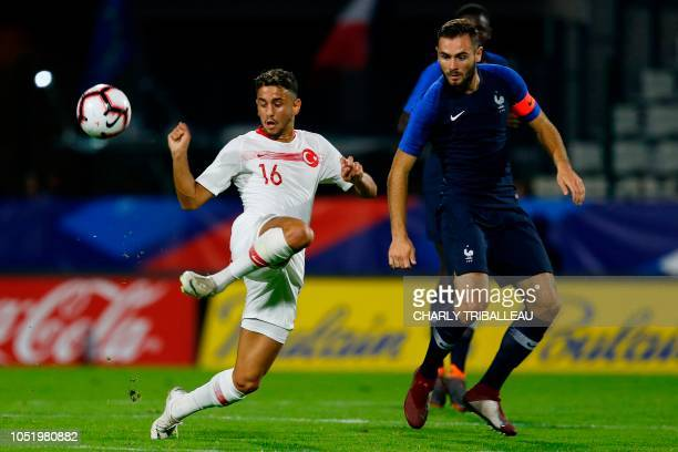 Turkey's forward Ahmet Canbaz vies for the ball with France's midfielder Lucas Tousart during the friendly under21 football match between France and...