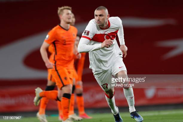 Turkey's forward Burak Yilmaz celebrates after scoring his second goal during the FIFA World Cup Qatar 2022 qualification Group G football match...
