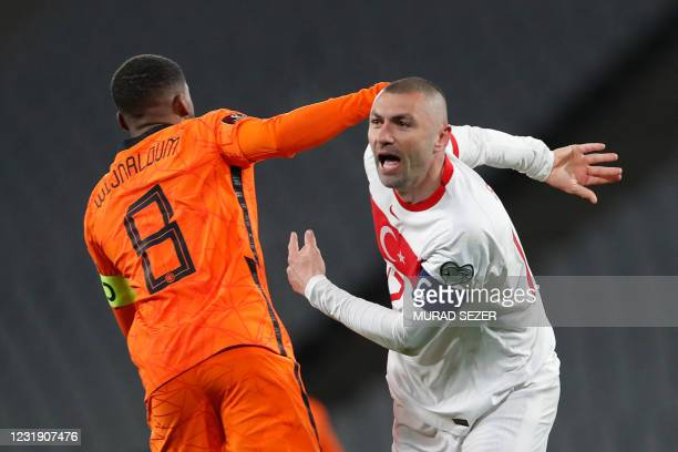 Turkey's forward Burak Yilmaz celebrates past Netherlands' midfielder Georginio Wijnaldumafter scoring the opener during the FIFA World Cup Qatar...