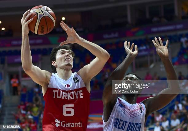 Turkey's forward Cedi Osman tries to shoot past Britain's center Gabe Olaseni during FIBA Eurobasket 2017 men's group D basketball match between...