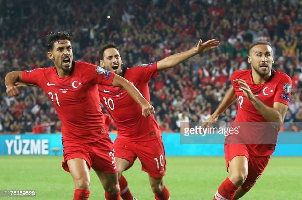 Turkey's forward Cenk Tosun celebrates with his team mates after scoring a goal during the Euro 2020 football qualification match between Turkey and...