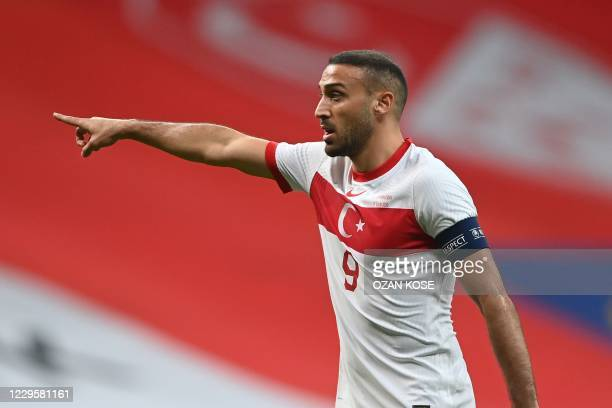 Turkey's forward Cenk Tosun gestures during the friendly football match between Turkey and Croatia at the Vodafone Park in Istanbul on November 11,...