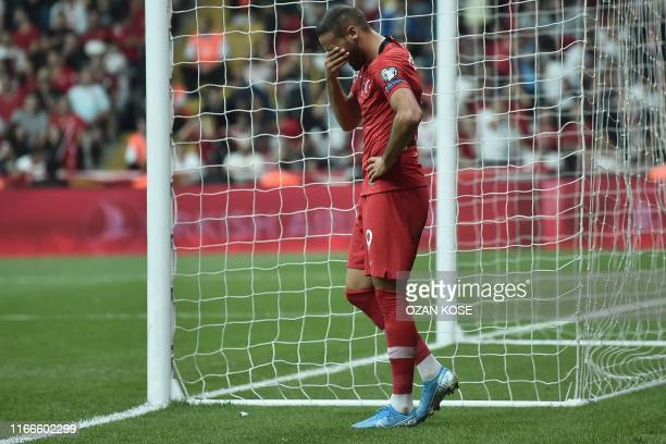 Turkey's forward Cenk Tosun reacts after missing a goal during the UEFA Euro 2020 qualifying Group H football match between Turkey and Andorra at...