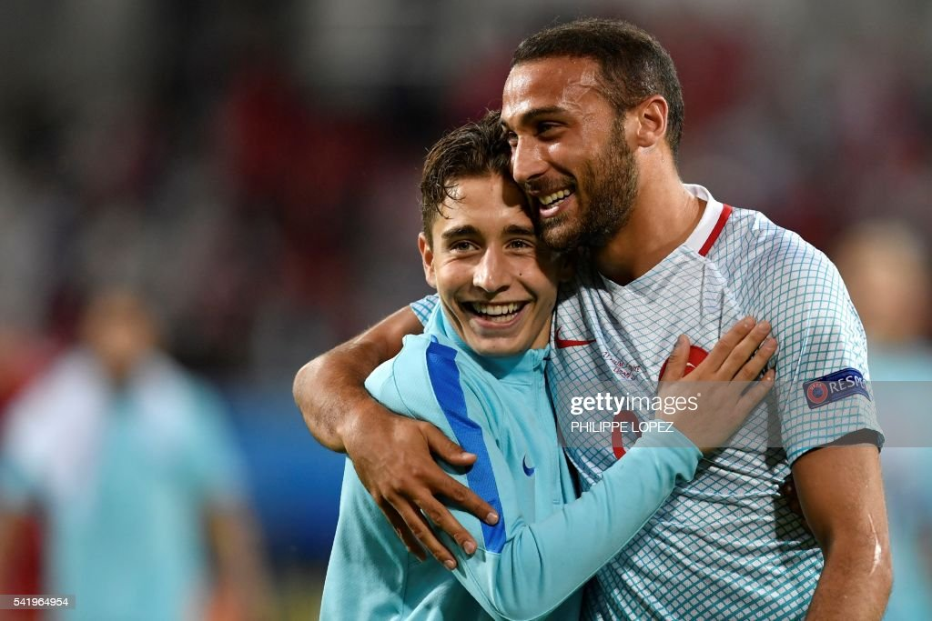 TOPSHOT - Turkey's forward Emre Mor (L) and Turkey's forward Cenk Tosun celebrate their team's victory at the end of the Euro 2016 group D football match between Czech Republic and Turkey at Bollaert-Delelis stadium in Lens on June 21, 2016. /