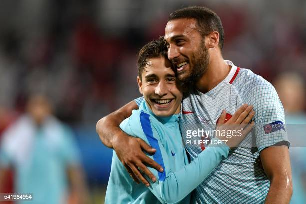 TOPSHOT Turkey's forward Emre Mor and Turkey's forward Cenk Tosun celebrate their team's victory at the end of the Euro 2016 group D football match...