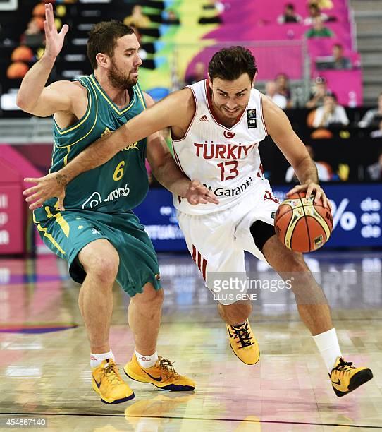 Turkey's forward Ender Arslan vies with Australia's guard Adam Gibson during the 2014 FIBA World basketball championships round of 16 match Turkey vs...