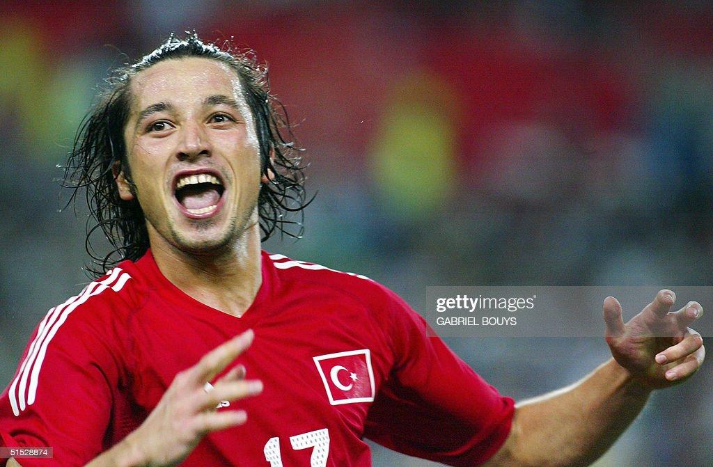 Turkey's forward Ilhan Mansiz celebrates after sco : News Photo