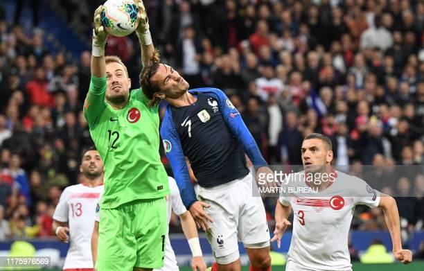 TOPSHOT Turkey's goalkeeper Mert Gunok vies with France's forward Antoine Griezmann past Turkey's defender Merih Demiral during the Euro 2020 Group H...