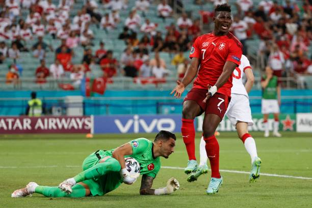 Turkey's goalkeeper Ugurcan Cakir gets to the ball ahead of Switzerland's forward Breel Embolo during the UEFA EURO 2020 Group A football match...