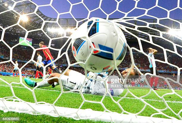 Turkey's goalkeeper Volkan Babacan lays in his goal as Spain's forward Alvaro Morata scores the 10 during the Euro 2016 group D football match...