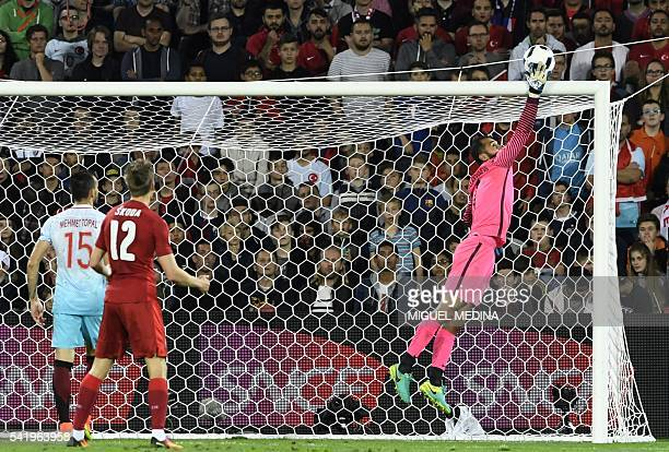 TOPSHOT Turkey's goalkeeper Volkan Babacan makes a save during the Euro 2016 group D football match between Czech Republic and Turkey at...