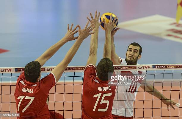 Turkey's Gokhan Gokgoz in action against Croatia's Ivan Mihalj Leo Andric during 2015 CEV Volleyball European League Men Pool B second match between...