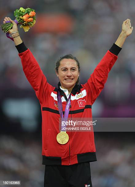 Turkey's gold medalist Asli Cakir poses on the podium of the women's 1500m at the athletics event of the London 2012 Olympic Games on August 11 2012...