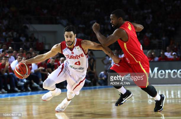 Turkey's guard Dogus Balbay dribbles the ball past Montenegro's guard Derek Needham during the 2019 FIBA Basketball World Championship European...