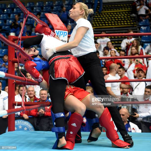 Turkey's Guluzar Kara is stopped by the referee during her fight against Serbia's Teodora Manic in the 'Women K1 65kg category' in the 'BOK' sports...