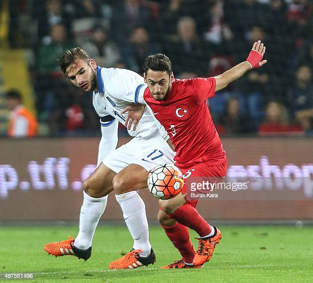 Turkey's Hakan Calhanoglu is in action with Greece's Panagiotis Tachtsidis during an international friendly soccer match between Greece and Turkey on...