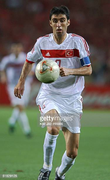 Turkey's Hakan Sukur chases the ball 29 June 2002 at the Daegu World Cup Stadium in Daegu during the thirdplace playoff between Korea and Turkey in...