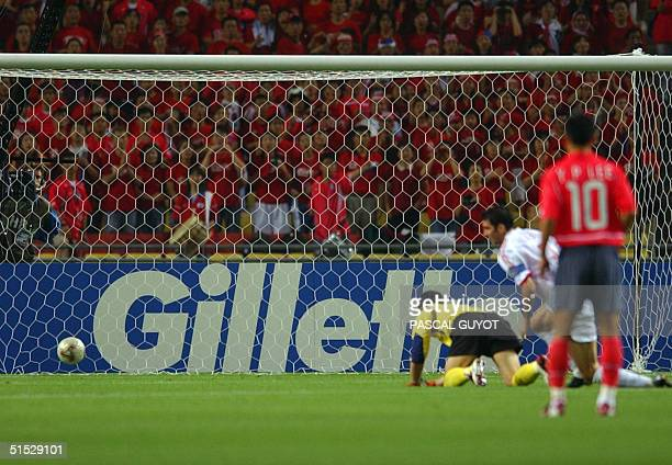 Turkey's Hakan Sukur watches his shot in the first minute roll into the back of the net 29 June 2002 at the Daegu World Cup Stadium in Daegu during...