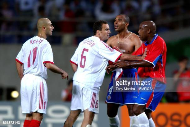 Turkey's Hasan Sas and Arif Erdem confront Costa Rica's Mauricio Wright and Hernan Medford