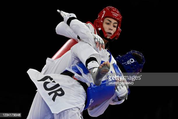 Turkey's Hatice Kubra Ilgun and Refugee Olympic Team's Kimia Alizadeh Zenoorin compete in the taekwondo women's -57kg bronze medal B bout during the...