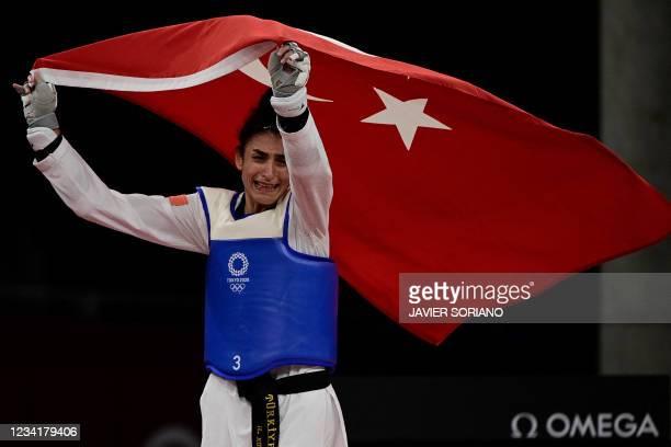 Turkey's Hatice Kubra Ilgun celebrates winning against Refugee Olympic Team's Kimia Alizadeh Zenoorin in the taekwondo women's -57kg bronze medal B...