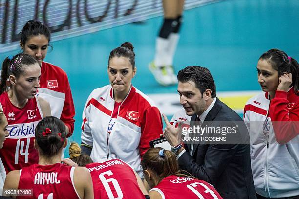 Turkey's head coach Akbas Ferhat addresses his players during the Women's EuroVolley 2015 quarterfinal match between Germany and Turkey in Antwerp,...