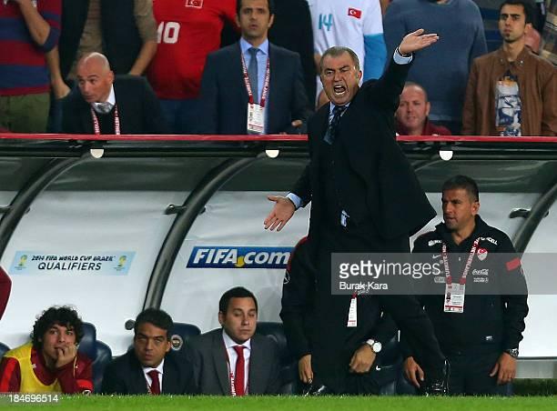 Turkey's head coach Fatih Terim gestures during FIFA 2014 World Cup Qualifier match at the Sukru Saracoglu Stadium on October 15 2013 in Istanbul...