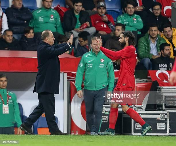 Turkey's head coach Fatih Terim gestures Turkey's Olcay Sahan during an international friendly soccer match between Greece and Turkey November 17...