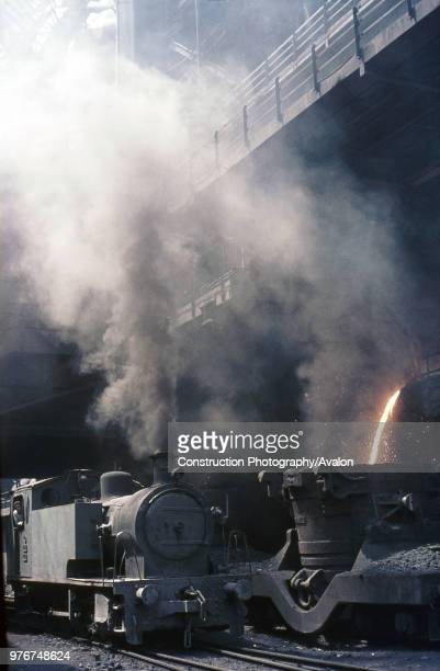 Turkey's Karabuk Steel Works on Thursday 10 August 1976 with Bagnall 080T No 4401 standing alongside molten waste being loaded into a ladle wagon