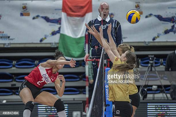 Turkeys Kirdar Gozde spikes the ball in front of Silge Wiebke of germany during the Women's EuroVolley 2015 quarterfinal match between Germany and...