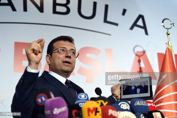 Turkey's main opposition party CHP candidate Ekrem Imamoglu who claimed victory as Istanbul mayor shows a picture of the 1994 local election...