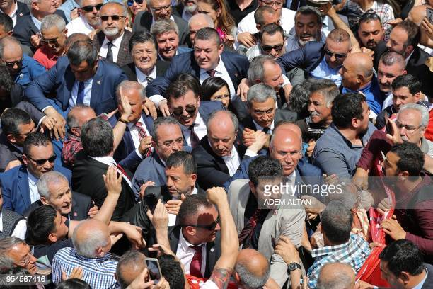 Turkey's main opposition Republican People's Party candidate for the upcoming snap presidential election Muharrem Ince crosses through supporters as...