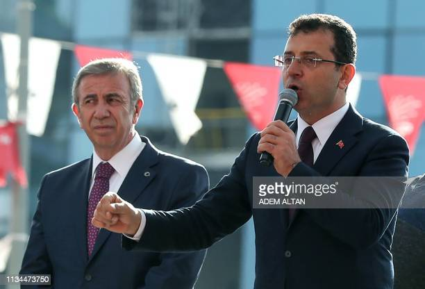Turkey's main opposition Republican People's Party leader Ekrem Imamoglu addresses supporters next to Mansur Yavas on April 2 2019 in front of their...