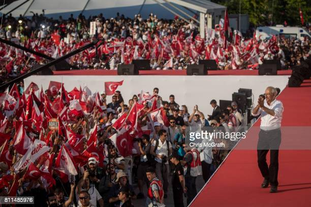 Turkey's main opposition Republican People's Party leader Kemal Kilicdaroglu throws flowers to supporters during the 'Justice Rally' on July 9 2017...