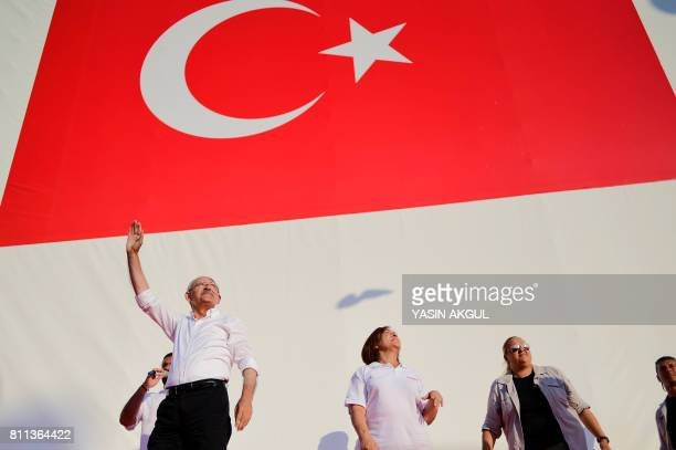 TOPSHOT Turkey's main opposition Republican People's Party leader Kemal Kilicdaroglu waves to supporters as he arrives for a rally in the Maltepe...